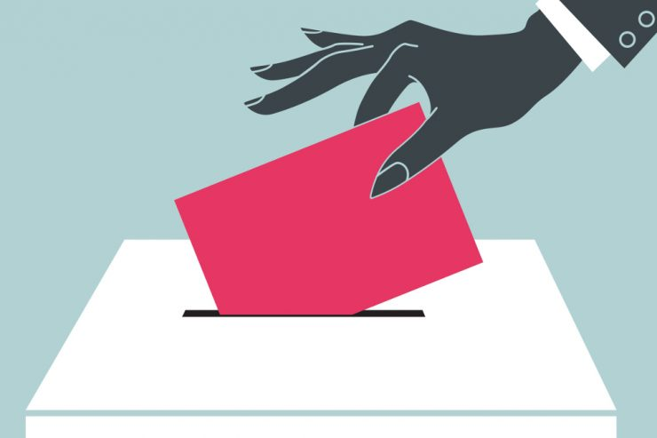 Zeichnung einer hand, die einen roten Wahlumschlag in eine Wahlurne wirft
